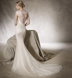 La Sposa - Hong Kong - A body-hugging wedding dress in satin with romantic lace details & sheer back.