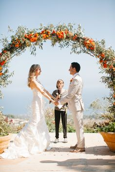 Photography : Erin Hearts Court | Coordination : Tricia Dahlgren | Venue : Rancho Del Cielo | Floral Design : Celebrate Flowers Read More on SMP: http://www.stylemepretty.com/2014/11/08/bright-orange-malibu-wedding/