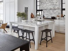 A Square Kitchen Island Includes Casual Seating In This Toronto Home Square Island Kitchen, Square Kitchen Layout, Kitchen Layouts With Island, Kitchen Island With Seating, Kitchen Islands, Eat At Kitchen Island, Island Bench, Small Galley Kitchens, Galley Kitchen Remodel