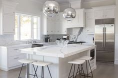 This super sleek white kitchen was completed by Bakes & Kropp. #luxeNYC