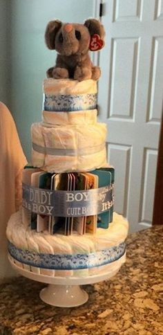 Diaper cake made for my friend's baby shower which had a book theme #diapercake #babyshower #bookthemedbabyshower
