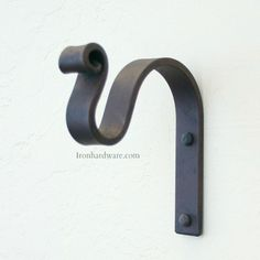 Our Hand Forged Solid Iron Traditional style mounting brackets. This classic wrought iron hook can be used for a variety of purposes.3/4 wide 5 high 5 wall to tip 3 1/2 wall to rod center. Fits 7/8 rods.