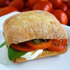 Fresh tomato, basil, mozzarella, and pesto Caprese sandwich. My favorite summer vegetable sandwich. It's the best ever!