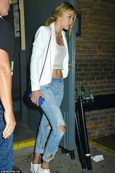 On the go: The Guess model in ripped jeans also on Sunday at the Hammerstein Ballroom...