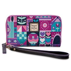 Disney It's A Small World Wallet by Dooney & Bourke New Happy memories of the beloved attraction will always be close at hand with this ''it's a small world'' wristlet. Fashioned in leather by Dooney