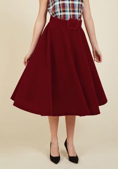 <p>Royally clothed in this red velvet skirt, you command attention and amass compliments, inspiring onlooking stylistas! With a swishing midi silhouette, a boldly buckled belt, and a way of making every outfit wow-worthy, this skirt offers ever-present panache that reigns over other ensembles.</p>