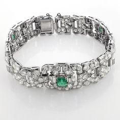 Vintage Fine Estate Jewelry: This stunning Vintage Platinum Diamond Bracelet with Emeralds showcases 1.75 carats of emeralds and 8.75 carats of breathtaking 216 round and 20 baguette diamonds. Featuring 3 gorgeous emeralds of green color and transparent clarity, this vintage art deco bracelet comes with the GAL certificate of authenticity. What a special unique gift!