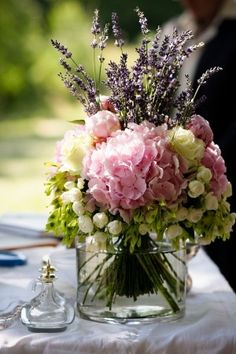 arrangement of pink hydrangeas, cream roses and lavender