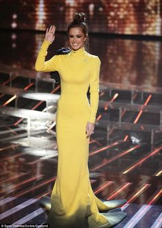 Mellow yellow: Cheryl, who was fighting to keep her last act Reggie N Bollie in the show, battled to ensure all eyes were on her in her luminous gown which clung to every inch of her superslim frame
