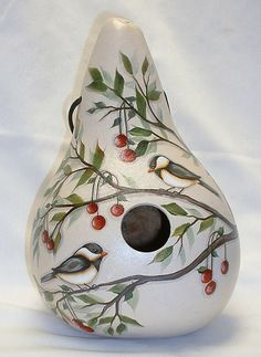 My chickadees and red cherries are painted on a martin house gourd. It is 11 tall and 23 around. Hangs from a black nylon cord with 3 drainage