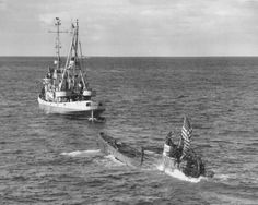 Captured German Submarine U-505 being towed to the Caribbean to be be hidden from the Germans. It's on display at Chicago's Museum of Science and Industry