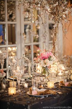 LOVE the bell jars and crystal cake stands! Such a romantic tablescape