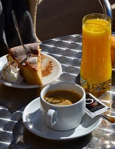 Almond cake and fresh orange juice in Soller, Mallorca, Spain