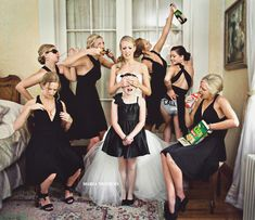 The bridesmaids roping in the flower girl for a funny shot. Bad influences haha!