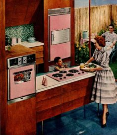 1961 Hotpoint Kitchen Ad.  Pink appliances, bright blue floor, and green tile.