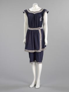Bathing costume | VA Search the Collections Women's bathing costume with skirt in navy wool, ca. 1910.  [http://collections.vam.ac.uk Credit Line: Given by Lady Leonard]