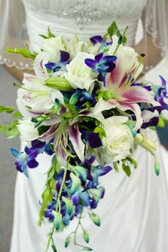 Wedding Bouquet - Roses, Tiger Lilies, filler, and some dangly stuff.