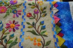 Karen Marchetti's quilting on  Kathryn's Spring Bouquet quilt. The pattern is by Edyta Sitar - Laundry Basket Quilts.  Kathryn changed up the inner borders a bit and added some fun prairie points.