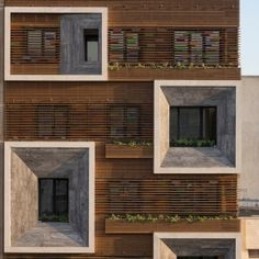Tehran+apartment+block+by+Keivani+Architects+features+faceted+window+frames+and+stained+glass