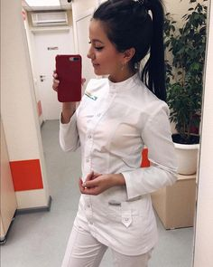 On # this # image # can # be: # 1 # person, # stands, # telephone, # part # of body # close-up # and # in # indoors - Uniform Spa Uniform, Scrubs Uniform, Dental Uniforms, Medical Scrubs, Female Doctor, Professional Women, Dentistry, School Looks, Blouse