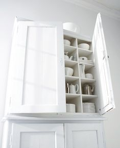 An all white painted kitchen cupboard