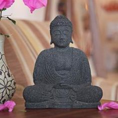 @Overstock - Color: Black  Materials: Volcanic ash and cement  Weight: 13 poundshttp://www.overstock.com/Worldstock-Fair-Trade/Stone-Serene-Buddha-Statuette-Indonesia/6355615/product.html?CID=214117 $29.24