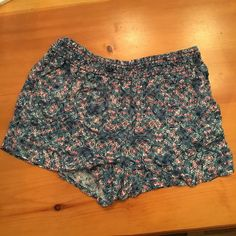 Pink and Blue Printed Shorts Flowy shorts with a pink, blue, and white pattern and pockets. They are in junior size 15. Shorts
