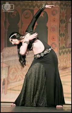 Although this is definitely a bellydance focused image, the costume looks so unique and elven to me