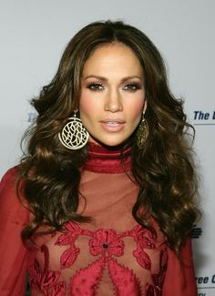 jLo looking fine in a transparent dress with flowers