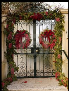 Gate with Christmas decorations. Wrought iron gate with Christmas wreaths , Christmas Door, Merry Little Christmas, Outdoor Christmas, All Things Christmas, Christmas Holidays, Christmas Wreaths, Christmas Decorations, Xmas, Christmas Ideas