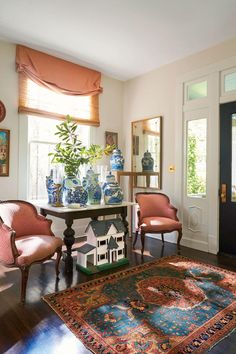 See How Colorful Decorating Ideas Transformed This 100-Year-Old, 2,500-Square-Foot Craftsman | Lonergan is a regular at secondhand stores in Houston and at the Original Round Top Antiques Fair—the sprawling, twice-yearly Texas show where she scoops up both big-name vintage pieces and regular old bits other people might term junk. #decorideas #homedecor #southernliving