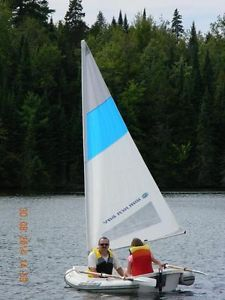 Fredericton $1500. Tel 474-1005 8 foot Walker Bay 275 RID sailboat rowboat with davits. The davits allow the boat to be attached to a larger vessel. Everything is in excellent order. Inflatable tube on the sides makes this boat very safe for kids. Row,sail or tow.  See attached you tube video.   http://youtu.be/iy5rAZ0ZsKk