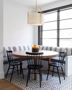 dining room 156007574578698384 - A white drum cage pendant hangs over an oval wood dining table placed on white and black mosaic floor tiles and seating two black Windsor dining chairs facing a white l-shaped dining banquette. Source by knatschinats Room Tiles Design, Dining Room Design, Dining Decor, New Kitchen, Kitchen Dining, Kitchen Decor, Kitchen Tables, Awesome Kitchen, Windsor Dining Chairs