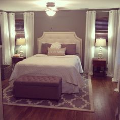 Love this bedroom set up- upholstered headboard, bench, white curtains, rug...minus the corny pillow