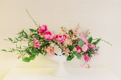 love the lowness to this arrangement-let's you see guests across the table