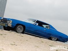 1974 Chevy Impala  My Brother's Car Lighter Blue with Bucket seats Automatic on the floor.  I Loved driving it. He let me use it while he was stationed in Germany.