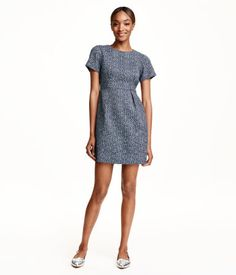 Short dress in jacquard-weave fabric with short sleeves, side-seam pockets, and concealed back zip.