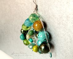 Jewelane by Fanni Szalai  Improvisation in blue-green... wood / metal / stone / acrylic beads / silver plated copper wire