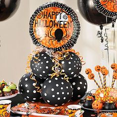 Give your modern Halloween tablescape a creepy-cute centerpiece! To DIY this display, tie together one layer of 4 balloons, repeat & tie together both layers. Top it off with a spider balloon & finish with a spray of ribbon!