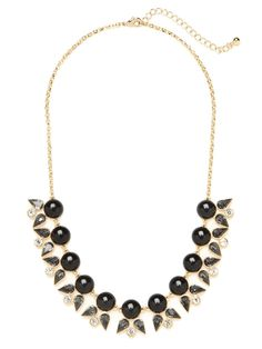 Talk about a stylish point-counterpoint. This striking necklace features a magnificent mix of motifs, from glossy cabochon gems to brilliant and blooming crystals.