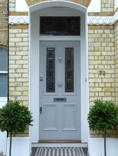 Looking to paint your front door a different color? These designers reveal their favorite front door colors. Victorian Front Doors, Grey Front Doors, Front Doors With Windows, Front Door Colors, Victorian Homes, Front Entry, Victorian Terrace House, House Front Door, Glass Front Door