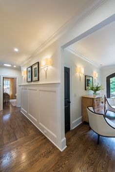 Hallway: sconces and wainscoting. love....love