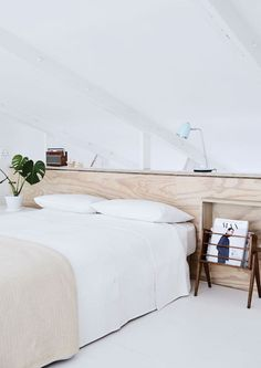 Bedroom Inspiration | Magazine rack next to the bed.