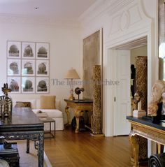 Richard Shapiro | A pair of distressed gilded columns flanks the entrance to the drawing room