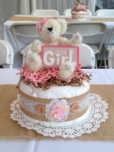 Pink and brown shabby shic baby shower centerpiece decoration made out of diaper cake.