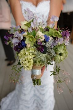 green and purple bouquet - check out the picture of the bride's dad pinned to it. Love it!
