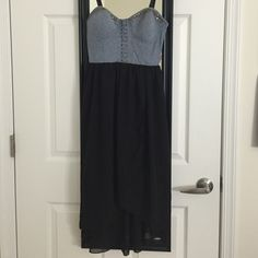 Gorgeous, stylish denim/black dress This is an absolutely beautiful dress!!! The top is shaped, reminiscent of a bodice/corset style, but without uncomfortable boning - it isn't too tight, it has a stretchy back to adjust to your body - and it has a built-in bra so you don't have to wear one. The bottom is black, made of a translucent fabric but with an opaque black skirt built in so nobody sees anything you don't want them to! The skirt is high-low style, and the spaghetti straps are…
