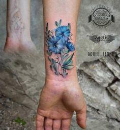 Blue watercolor flowers on wrist by Lenara