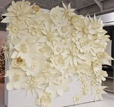 wedding backdrop - Huge white paper flowers pinned on the trees in an arch to form centered back drop #Wedding #Backdrop