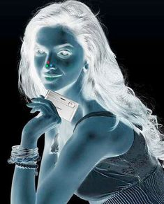 This seriously works!                                                 1. Stare at the red dot on the girl's nose for 30 seconds                                                2. Turn your eyes towards the wall/roof or somewhere else on a plain surface  3. Keep blinking your eyes quickly.